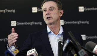Former Louisville basketball coach Rick Pitino talks to reporters during a news conference in New York, Wednesday, Feb. 21, 2018. Pitino helds the news conference in the wake of an NCAA decision in a sex scandal case that strips the Cardinals program of 123 victories, a national championship and $600,000 in post-season revenue. (AP Photo/Seth Wenig)