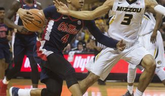 Mississippi's Breein Tyree, left, dribbles past Missouri's Kassius Robertson, right, during the first half of an NCAA college basketball game Tuesday, Feb. 20, 2018, in Columbia, Mo. (AP Photo/L.G. Patterson)