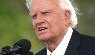 In this June 26, 2005 photo, the Rev. Billy Graham speaks on stage on the third and last day of his farewell American revival in the Queens borough of New York. A spokesman said on Graham has died at his home in North Carolina at age 99. (AP Photo/Henny Ray Abrams/File)