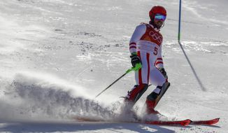 Marcel Hirscher, of Austria, skies into the finish area after the first run of the men's slalom at the 2018 Winter Olympics in Pyeongchang, South Korea, Thursday, Feb. 22, 2018. (AP Photo/Morry Gash)