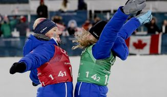 United States' Jessica Diggins, right, and Kikkan Randall celebrate after winning the gold medal in the women's team sprint freestyle cross-country skiing final at the 2018 Winter Olympics in Pyeongchang, South Korea, Wednesday, Feb. 21, 2018. (AP Photo/Matthias Schrader)