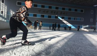 In this Feb. 1, 2018 photo, a North Korean boy enjoys a day off during winter break from school at the Indoor Skating Rink in Pyongyang, North Korea. Though not known for its prowess at winter sports, North Korea decided at the last minute to send a couple dozen athletes to the Pyeongchang Winter Olympics in South Korea. (AP Photo/Eric Talmadge)