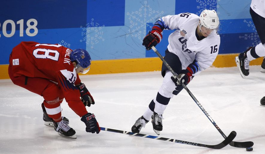 Ryan Donato (16), of the United States, skates with the puck past Dominik Kubalik (18), of the Czech Republic, during the second period of the quarterfinal round of the men's hockey game at the 2018 Winter Olympics in Gangneung, South Korea, Wednesday, Feb. 21, 2018. (AP Photo/Jae C. Hong)