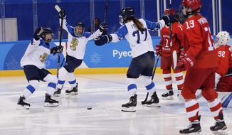 Susanna Tapani (77), of Finland, celebrates with teammates after scoring a goal during the second period of the women's bronze medal hockey game against the team from Russia at the 2018 Winter Olympics in Gangneung, South Korea, Wednesday, Feb. 21, 2018. (AP Photo/Frank Franklin II)