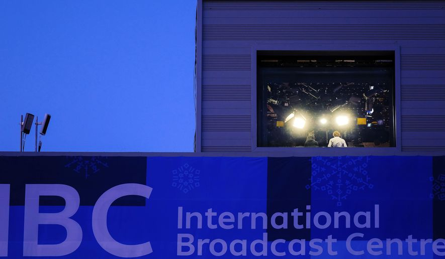 Television personnel work inside of the International Broadcast Center at the 2018 Winter Olympics in Pyeongchang, South Korea, Wednesday, Feb. 21, 2018. Live television has always presented challenges, but NBC's Olympic stumbles this month have unfolded before an audience ready to pounce. (AP Photo/J. David Ake)