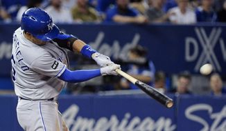 FILE - In this Sept. 20, 2017, file photo, Kansas City Royals' Whit Merrifield hits a solo home run against the Toronto Blue Jays during the sixth inning of a baseball game, in Toronto. Merrifield fought every spring to make the Royals roster, usually to no avail. Once he broke through, he made sure he would never give his spot away. (Nathan Denette/The Canadian Press via AP, File)