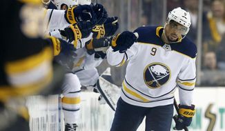 FILe - In this Feb. 10, 2018, file photo, Buffalo Sabres' Evander Kane (9) celebrates his goal during the second period of an NHL hockey game against the Boston Bruins, in Boston. Kane acknowledges it's a matter of when he'll be dealt and not if before the NHL's trading deadline hits on Monday. Kane is in the final year of his contract and not expected to be re-signed by the Sabres this offseason. (AP Photo/Michael Dwyer, File)