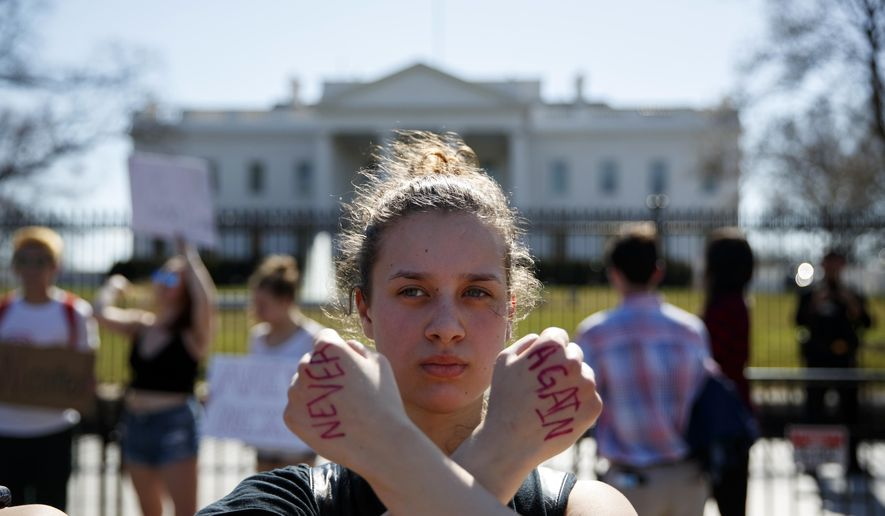 Gwendolyn Frantz, 17, of Kensington, Md., stands in front of the White House during a student protest for gun control, Wednesday, Feb. 21, 2018, in Washington. (AP Photo/Evan Vucci)