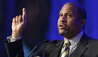 FILE - In this May 29, 2014 file photo, author and talk show host Tavis Smiley speaks at Book Expo America in New York. Smiley is suing his former employer, the Public Broadcasting Service, for breach of contract after he was fired over sexual harassment allegations. The Washington Post reports that the lawsuit was filed Tuesday, Feb. 20, 2018, in D.C. Superior Court against PBS, based in the Washington suburb of Arlington, Virginia. (AP Photo/Mark Lennihan, File)