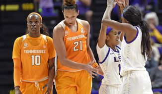 FILE - In this Jan. 28, 2018, file photo, Tennessee guard Meme Jackson (10) and center Mercedes Russell (21) walk by LSU's Jaelyn Richard-Harris (13) as she celebrates with guard Raigyne Louis (11) in the closing moments of LSU's 70-59 win in an NCAA college basketball game in Baton Rouge, La. After getting off to a 15-0 start, No. 15 Tennessee has split its last 12 games to fall to its lowest ranking of the season. A two-game skid has dropped the Lady Vols to a tie for sixth place in the Southeastern Conference. They're spending the final week of the regular season trying to sort out their problems and regain the momentum they had earlier this year. (AP Photo/Bill Feig, File)