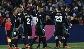 Real Madrid's Casemiro, centre, celebrates with teammates after scoring his side's second goal against Leganes during a Spanish La Liga soccer match between Real Madrid and Leganes at the Butarque stadium in Leganes, outside Madrid, Wednesday, Feb. 21, 2018. (AP Photo/Francisco Seco)