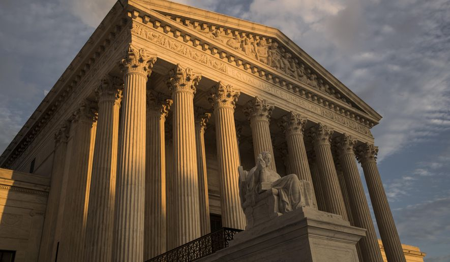 In this Oct. 10, 2017, file photo, the Supreme Court in Washington, at sunset.  (AP Photo/J. Scott Applewhite, File) **FILE**