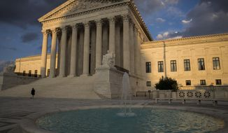 In this Oct. 10, 2017, file photo, the Supreme Court in Washington is seen at sunset. (AP Photo/J. Scott Applewhite) ** FILE **