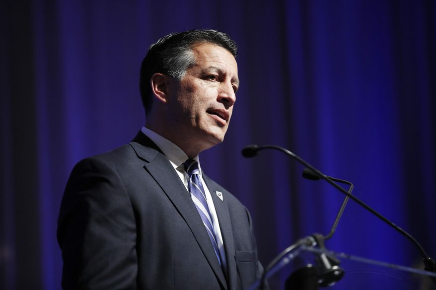 FILE - In this Dec. 5, 2017, file photo, Nevada Gov. Brian Sandoval speaks at the Governor's Global Tourism Summit in Las Vegas. Sandoval and some of the state's federal lawmakers are welcoming President Donald Trump's call for a ban on devices that authorities say helped a gunman kill 58 people in the deadliest mass shooting in modern U.S. history. (AP Photo/John Locher, File)