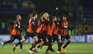 Shakhtar's Fred celebrates with his teammates after scoring his side's second goal during the Champions League, round of 16, first-leg soccer match between Shakhtar Donetsk and Roma at the Metalist Stadium in Kharkiv, Ukraine, Wednesday, Feb. 21, 2018. (AP Photo/Efrem Lukatsky)