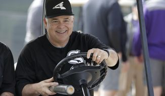 FILE - In this Feb. 17, 2018, file photo, Chicago White Sox manager Rick Renteria drives a cart at the team's spring training baseball facility in Glendale, Ariz. Renteria enters his second season as the White Sox bursting with optimism about the future of the organization. That's because the team has loaded up on promising young players. (AP Photo/Carlos Osorio, File)