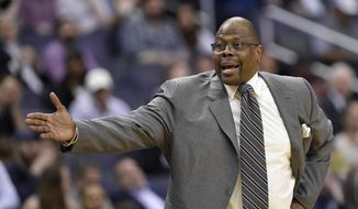 Georgetown head coach Patrick Ewing gestures during the second half of an NCAA college basketball game against Xavier, Wednesday, Feb. 21, 2018, in Washington. (AP Photo/Nick Wass) ** FILE **