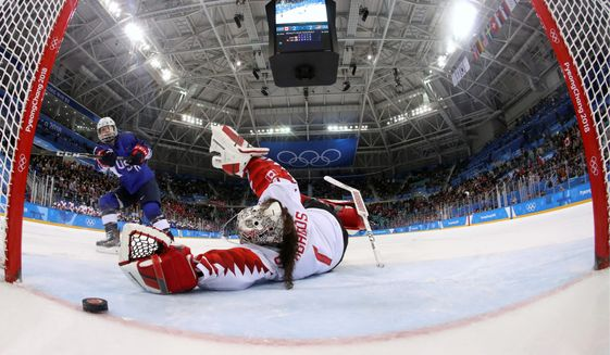 American Jocelyne Lamoureux-Davidson's jaw-dropping triple-deke stymies Canadian goalie Shannon Szabados for the go-ahead goal in a shootout Thursday to win the women's gold medal in Gangneung, South Korea. (ASSOCIATED PRESS PHOTOGRAPHS)