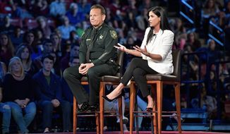 NRA spokeswoman Dana Loesch fields questions, sitting next to Broward Sheriff Scott Israel during a CNN town hall meeting. (Associated Press)