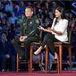 NRA spokeswoman Dana Loesch fields questions, sitting next to Broward Sheriff Scott Israel during a CNN town hall meeting. (Associated Press)