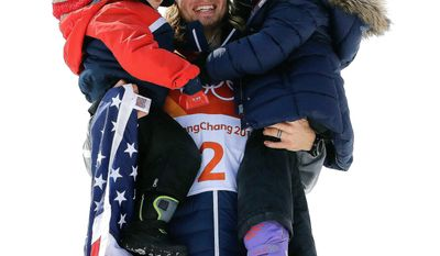 American David Wise celebrates with his daughter Nayeli (right) and son Malachi after winning his second-straight gold medal in the men's halfpipe freestyle skiing on Thursday.