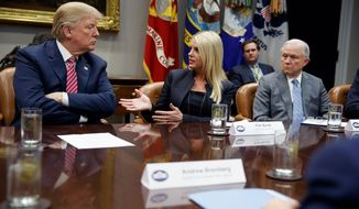 """I want to end the problem,"" said President Trump during a White House meeting. His proposal includes raising the age limit to 21 for buying semiautomatic rifles. (Associated Press)"