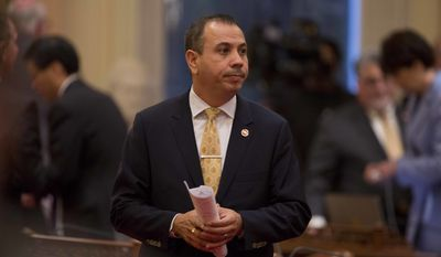 Democratic State Sen. Tony Mendoza stands on the floor of the Senate chambers in between private meetings of the Democratic caucus, Wednesday, Jan. 3, 2018, in Sacramento, Calif. Mendoza's colleagues debated whether to suspend him amid a sexual misconduct investigation during the opening day of the Senate. (AP Photo/Steve Yeater)