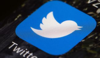 FILE- This April 26, 2017, file photo shows the Twitter icon on a mobile phone, in Philadelphia. Twitter reports earnings Thursday, Feb. 8, 2018. (AP Photo/Matt Rourke, File)