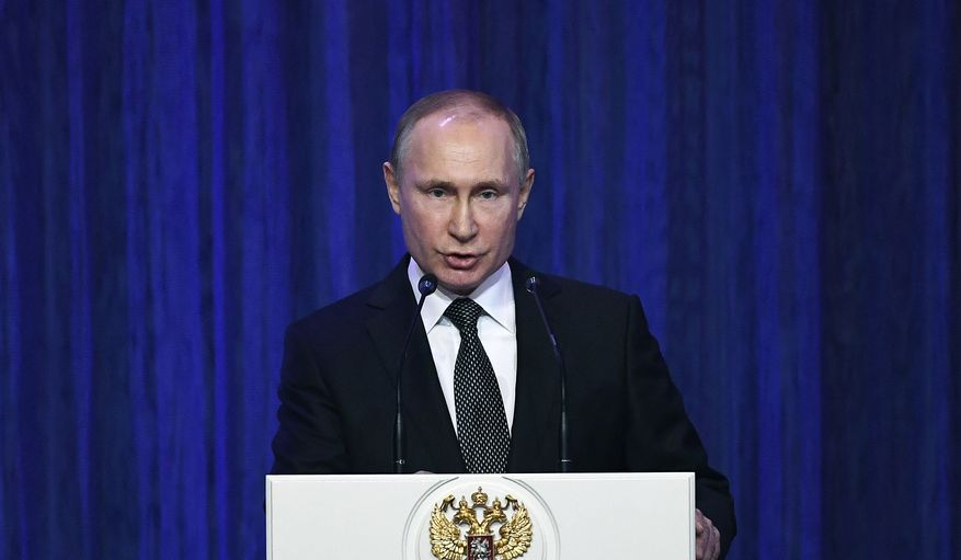 Russian President Vladimir Putin delivers his speech at the Grand Kremlin Palace marking the Defender of the Fatherland Day in Moscow, Russia, Thursday, Feb. 22, 2018. (Yuri Kadobnov/Pool Photo via AP)