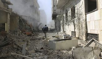 In this photo released on Thursday, Feb. 22, 2018, which provided by the Syrian anti-government activist group Ghouta Media Center, which has been authenticated based on its contents and other AP reporting, shows a Syrian man runs between destroyed buildings which attacked during airstrikes and shelling by Syrian government forces, in Ghouta, a suburb of Damascus, Syria. (Ghouta Media Center via AP)