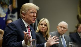 Florida Attorney General Pam Bondi, center, and Attorney General Jeff Sessions, right, look on as President Donald Trump speaks during a meeting with state and local officials to discuss school safety, in the Roosevelt Room of the White House, Thursday, Feb. 22, 2018, in Washington. (AP Photo/Evan Vucci)