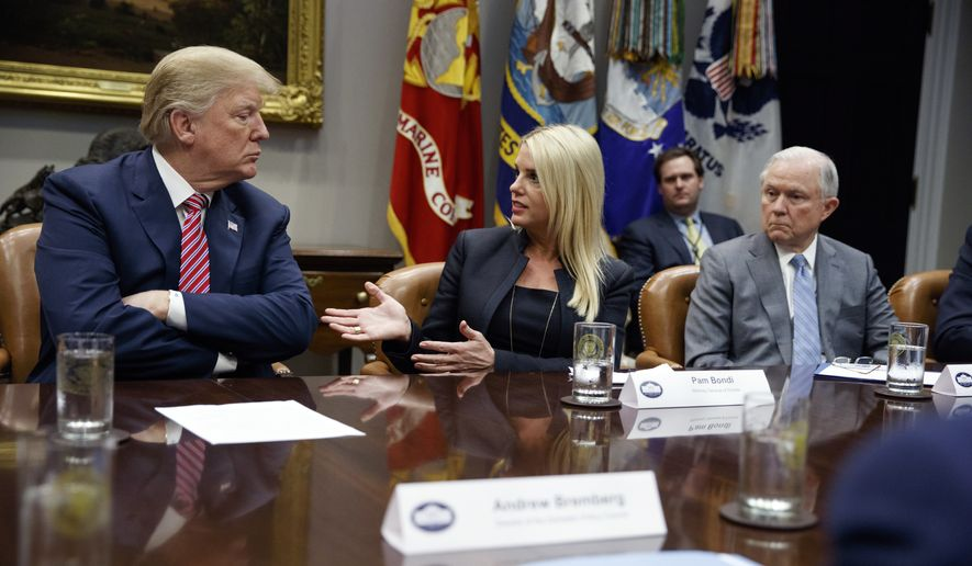 President Donald Trump, left, and Attorney General Jeff Sessions, right, listen as Florida Attorney General Pam Bondi speaks during a meeting with state and local officials to discuss school safety, in the Roosevelt Room of the White House, Thursday, Feb. 22, 2018, in Washington. (AP Photo/Evan Vucci)