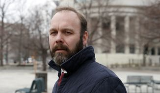 in this Feb. 14, 2018, file photo, Rick Gates departs Federal District Court in Washington. In a dramatic escalation of pressure and stakes, special counsel Robert Mueller filed additional criminal charges Thursday against President Donald Trump's former campaign chairman Paul Manafort and his business associate, Gates. (AP Photo/Alex Brandon, File)