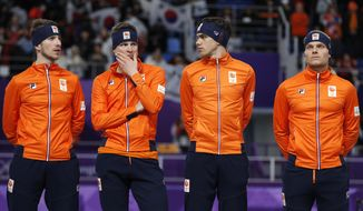 Bronze medalist team Netherlands with Jan Blokhuijsen, Sven Kramer, Patrick Roest and Koen Verweij, from left to right, appear dejected on the podium after the men's team pursuit speedskating race at the Gangneung Oval at the 2018 Winter Olympics in Gangneung, South Korea, Wednesday, Feb. 21, 2018. (AP Photo/John Locher)