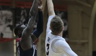 Arizona's Deandre Ayton, left, has his shot blocked by Oregon State's Tres Tinkle (3) in the first half of an NCAA college basketball game in Corvallis, Ore., Thursday, Feb. 22, 2018. (AP Photo/Timothy J. Gonzalez)