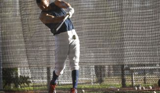 Houston Astros shortstop Carlos Correa (1) puts in some time in the batting cages during baseball spring training, Thursday, Feb. 22, 2018 in West Palm Beach, Fla. (Karen Warren/Houston Chronicle via AP)