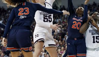 Mississippi State forward Chloe Bibby (55) makes a layup against Auburn during the second half of an NCAA college basketball game in Starkville, Miss., Thursday, Feb. 22, 2018. Mississippi State won 82-61. (AP Photo/Rogelio V. Solis)