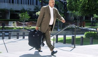 FILE - In this Oct. 4, 2016, file photo, North Carolina concert promoter Marc Hubbard walks to federal court in Honolulu. Hubbard, who admitted to defrauding the University of Hawaii of $200,000 by lying about being able to produce a Stevie Wonder fundraiser concert, now wants to take back his guilty plea. A judge postponed Hubbard's sentencing hearing Thursday, Feb. 22, 2018, because he filed a motion to withdraw his guilty plea. U.S. District Judge Leslie Kobayashi set a hearing for March on whether he'll be allowed to take his plea back. (Dennis Oda/The Star-Advertiser via AP, File)