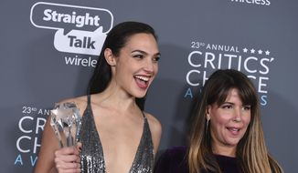 """In this Jan. 11, 2018, file photo, Gal Gadot, left, and Patty Jenkins, winners of the award for best action movie for """"Wonder Woman"""", pose in the press room at the 23rd annual Critics' Choice Awards at the Barker Hangar in Santa Monica, Calif. (Photo by Jordan Strauss/Invision/AP, File)"""