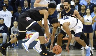 Gonzaga forward Johnathan Williams (3) fights for a loose ball with San Diego guard Isaiah Wright (22) during the first half of an NCAA college basketball game Thursday, Feb. 22, 2018, in San Diego. (AP Photo/Denis Poroy)