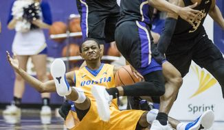 Hofstra guard Desure Buie (4) reacts after losing his balance during the first half of an NCAA college basketball game against James Madison in Harrisonburg, Va., Thursday, Feb. 22, 2018. (Daniel Lin/Daily News-Record via AP)