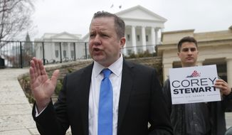 Virginia GOP senatorial hopeful, Corey Stewart, gestures during a news conference at the Capitol in Richmond, Va., Thursday, Feb. 22, 2018. Stewart called out Republican lawmakers not to approve Medicaid expansion. (AP Photo/Steve Helber)