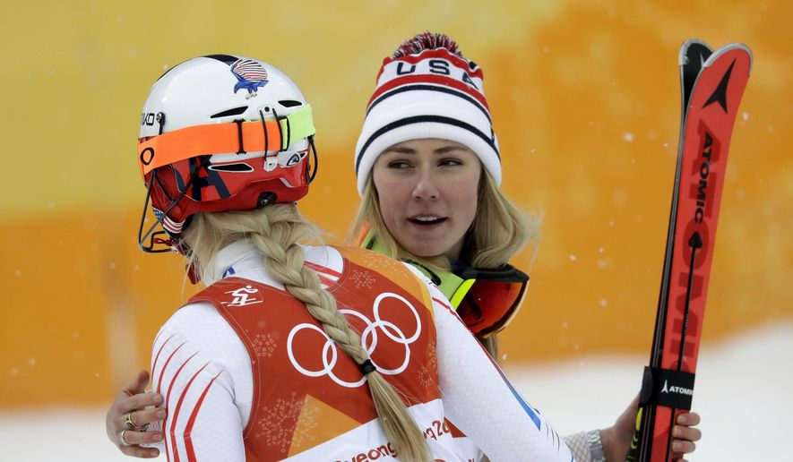 Mikaela Shiffrin, of the United States, right, hugs compatriot Lindsey Vonn after the women's combined slalom at the 2018 Winter Olympics in Jeongseon, South Korea, Thursday, Feb. 22, 2018. (AP Photo/Michael Probst)