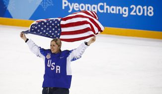 United States' Gigi Marvin celebrates with the team after winning the women's gold medal hockey game against Canada at the 2018 Winter Olympics in Gangneung, South Korea, Thursday, Feb. 22, 2018. (AP Photo/Jae C. Hong)