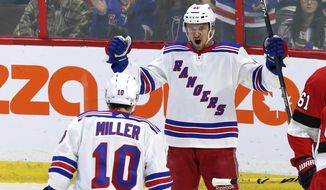 New York Rangers right wing Michael Grabner (40) celebrates his goal against the Ottawa Senators with teammate left wing J.T. Miller (10) during the first period of an NHL hockey game, Saturday, Feb. 17, 2018 in Ottawa, Ontario. (Fred Chartrand/The Canadian Press via AP)