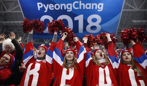 Russian fans cheer while watching the quarterfinal round of the men's hockey game between Norway and the team from Russia at the 2018 Winter Olympics in Gangneung, South Korea, Wednesday, Feb. 21, 2018. (AP Photo/Jae C. Hong)