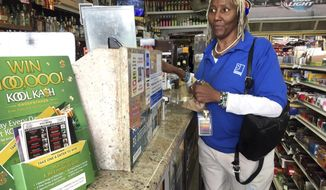 San Francisco Goodwill store employee Debra Shaw, shops inside Frank's liquor store on Haight Street in San Francisco Thursday, Feb. 22, 2018. Shaw said she was saddened and horrified by the news that three men were found dead outside a private high school in the Haight-Ashbury neighborhood. She says she walks by the school all the time and knows that drugs are a problem. (AP Photo/Janie Har)