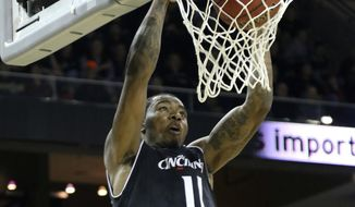 Cincinnati's Gary Clakk dunks during the first half of an NCAA college basketball game against Connecticut, Thursday Feb. 22, 2018, in Highland Heights, Ky. (AP Photo/Tony Tribble)