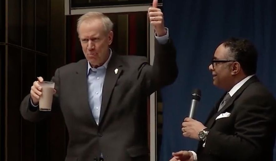 Illinois Gov. Bruce Rauner took a large gulp of chocolate milk in front of a Chicago crowd Wednesday in order to demonstrate his support for workplace diversity. (Video screenshot via Chicago Tribune)