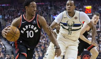 Toronto Raptors guard DeMar DeRozan (10) drives past Milwaukee Bucks forward John Henson (31) during the first half of an NBA basketball game Friday, Feb. 23, 2018, in Toronto. (Chris Young/The Canadian Press via AP) **File**